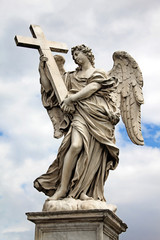 Angel with cross at the famous Sant' Angelo bridge in Rome, Ital