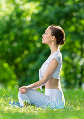 Profile of girl who sits in asana position zen gesturing