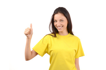 Happy girl with yellow t-shirt signing thumbs up.