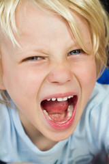 Close-up of an angry screaming child