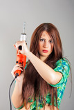 young woman holding a power tool