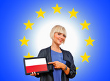 woman holding tablet with poland flag on european union backgro
