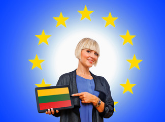 woman holding tablet with lithuania flag on european union back
