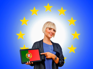 woman holding tablet with united portugal on european union bac