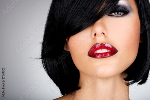 Beautiful brunette woman with shot hairstyle and sexy red lips
