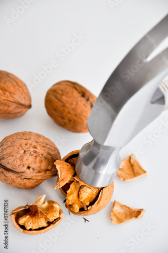 Cracking nuts isolated on white background
