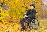 Happy handicapped senior enjoying the autumn sun
