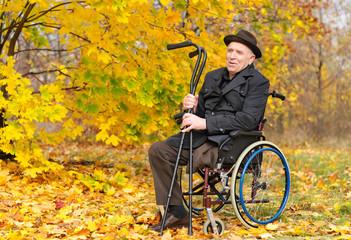 Happy handicapped senior enjoying the autumn sun