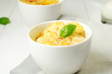 Potato gratin in the white bowls
