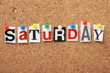 The word Saturday on a cork notice board