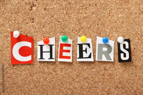 The word Cheers on a cork notice board