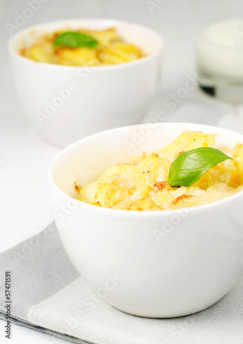 Potato gratin in the white bowl