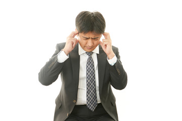 頭痛のビジネスマン