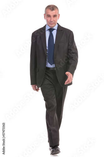 business man walks to you