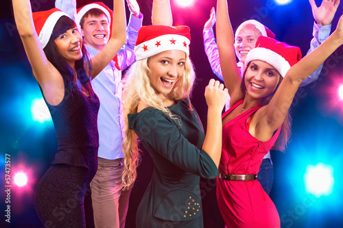 Happy people in Santa hats