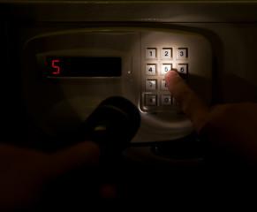 pressing a safebox in a dark space