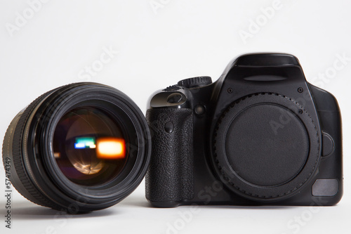 Modern digital photo camera with 85 mm lens