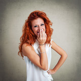 Happy redhead woman portrait against grunge background.