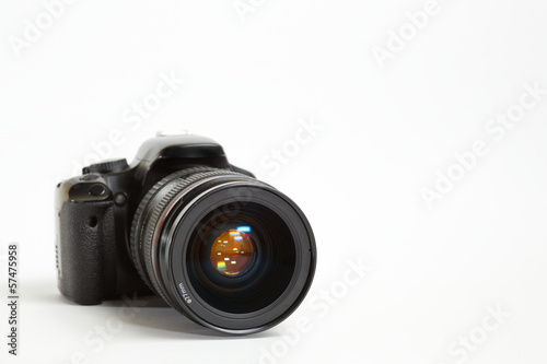 Modern digital photo camera with 24-70mm lens