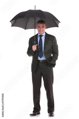 business man holds his umbrella