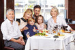Portrait of a family at dining table