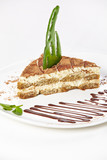 Tiramisu with chocolate sauce and caramel decor