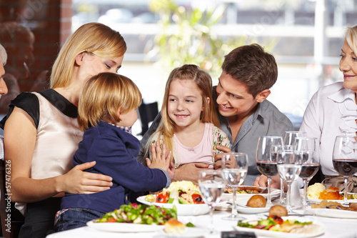 Children playing in restaurant - 57476326