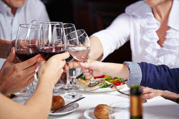 Friends toasting with glasses in restaurant