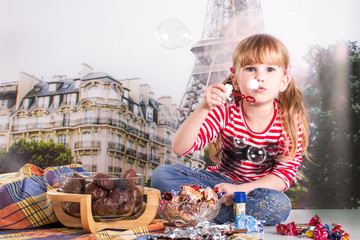 Girl with sweets. bubble blower