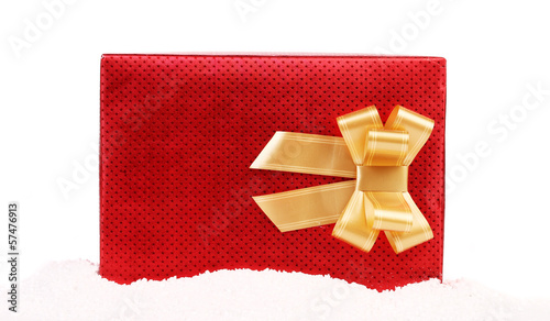 Red gift box with golden bow.