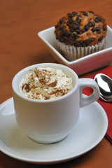 Viennese coffee with cinnamon and chocolate muffins
