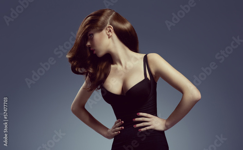 beautiful and attractive young brunette lady in elegant black dr