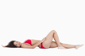 Attractive woman lying down while looking at the camera