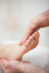 Physiotherapist offering a foot massage