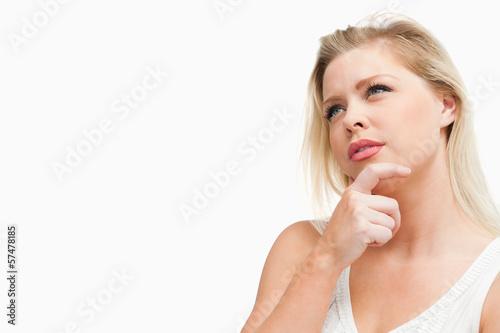 Attractive blonde woman lost in thoughts