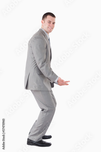 Portrait of a smiling businessman carrying something