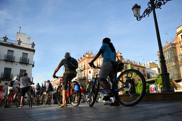 Tourists cycling in the city, Seville, Spain