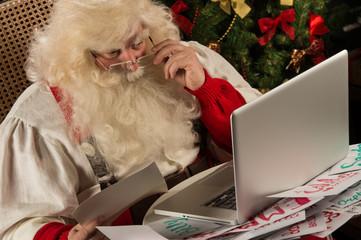 Santa Claus working on computer