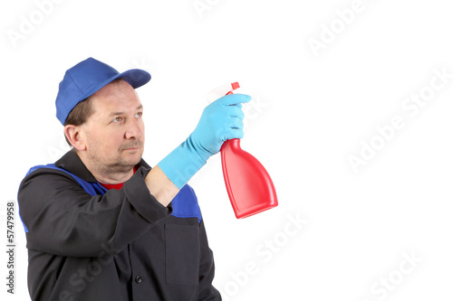 Man holds spray bottle.