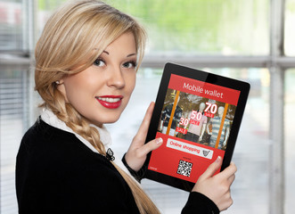 businesswoman holding tablet with onlain shopping on the screen