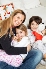 Loving Mother With Children During Christmas