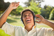 Man raising his arms while listening to music