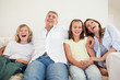 Laughing family sitting on the sofa