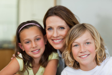 Smiling mother with children