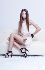 beautiful brunette young woman in white dress and black shoes