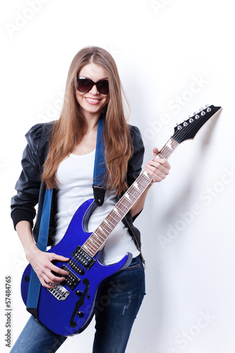 young beautiful woman with electric guitar