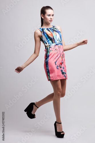full length high fashion portrait of beautiful stylish woman