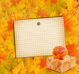 Autumn maple branch with gift box on the abstract background