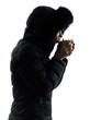 woman winter coat drinking hot drink  silhouette