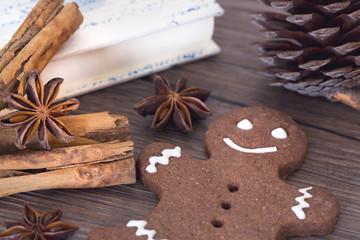 Gingerbread man, cookies, star anise, cinnamon and cookbook